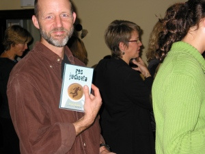 Author Steven Laffoley picks up a signed copy of Res Judicata at the Halifax launch.